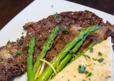 odonnells-market-what-we-offer-butcher-ny-strip-steak-grilled-scalloped-potato-asparagus